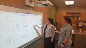 Teachers using Brightlink during training