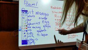 Student and teacher using Epson Brightlink