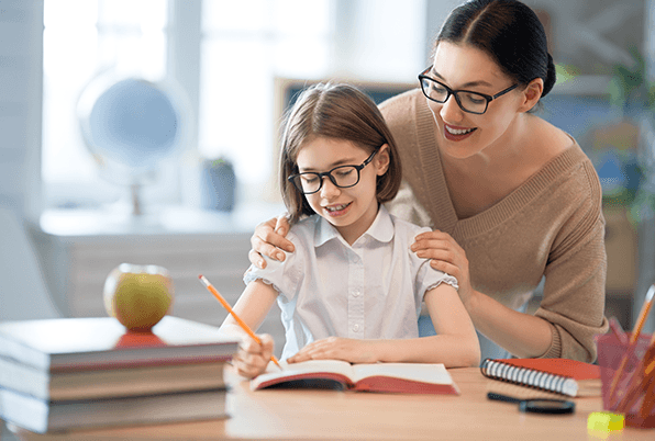 Girl and teacher working together smiling