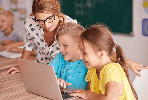 Teacher with students using laptop